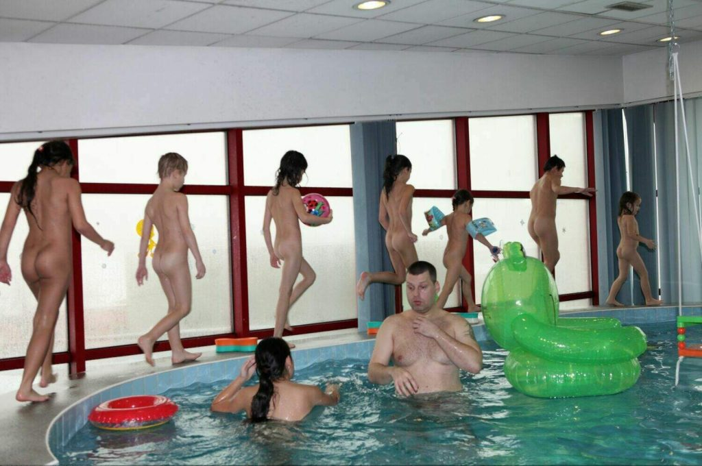 Family naturist day swimming pure nudism photo