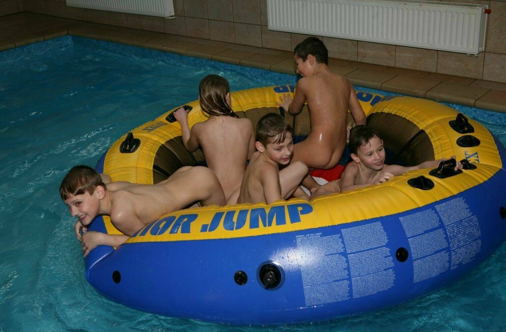 Funny weekend family naturists spent in the pool